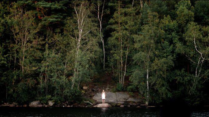 woman standing at lake