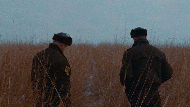 men standing in field